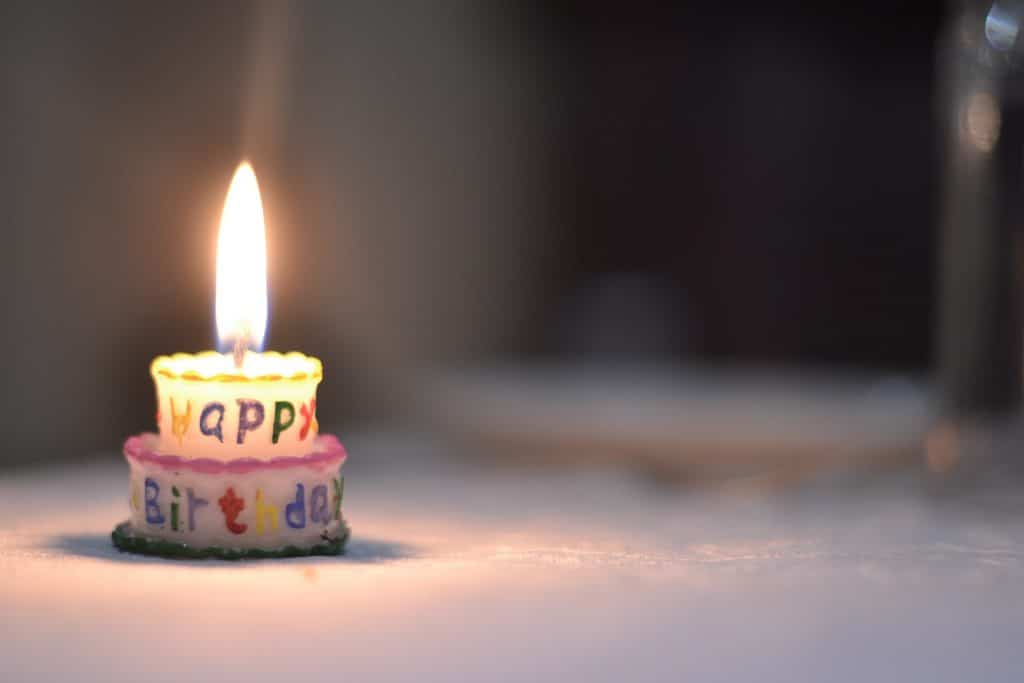 a happy birtday cake with candle