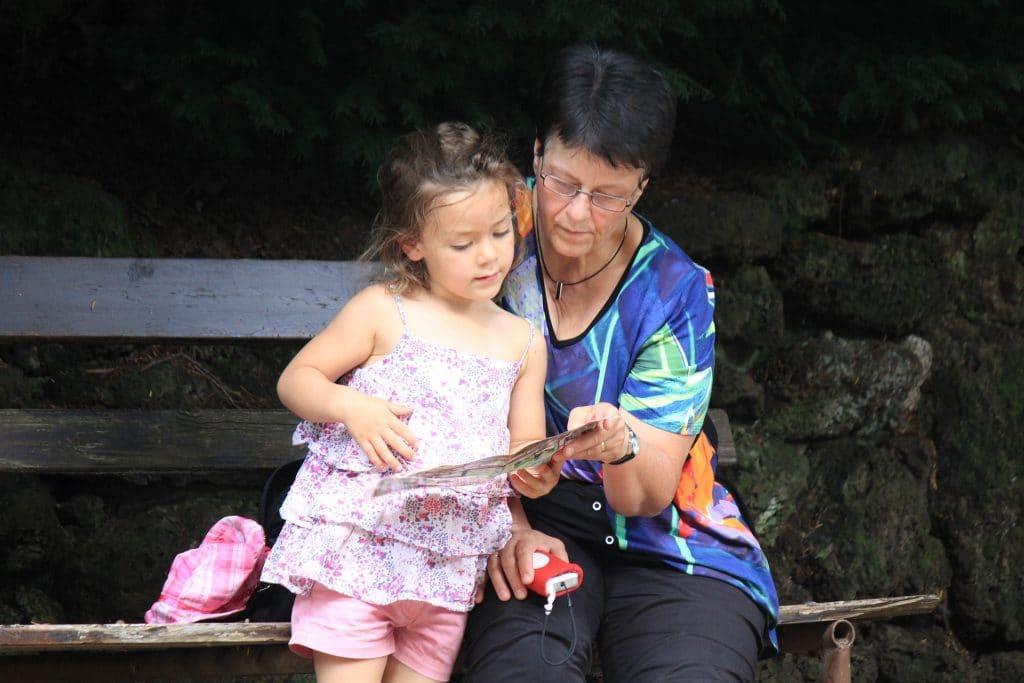 grandma reading to her granddaughter