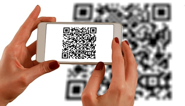 hands-smartphone-barcodes-qr-