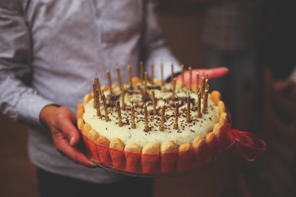 man holding a birthday cake