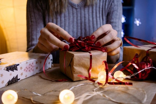 lady wrapping a gift