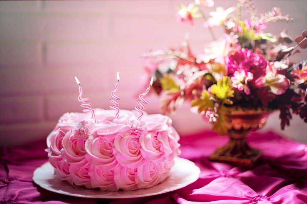 pink flowered style birthday cake