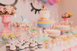 colorful birthday cakes in the table